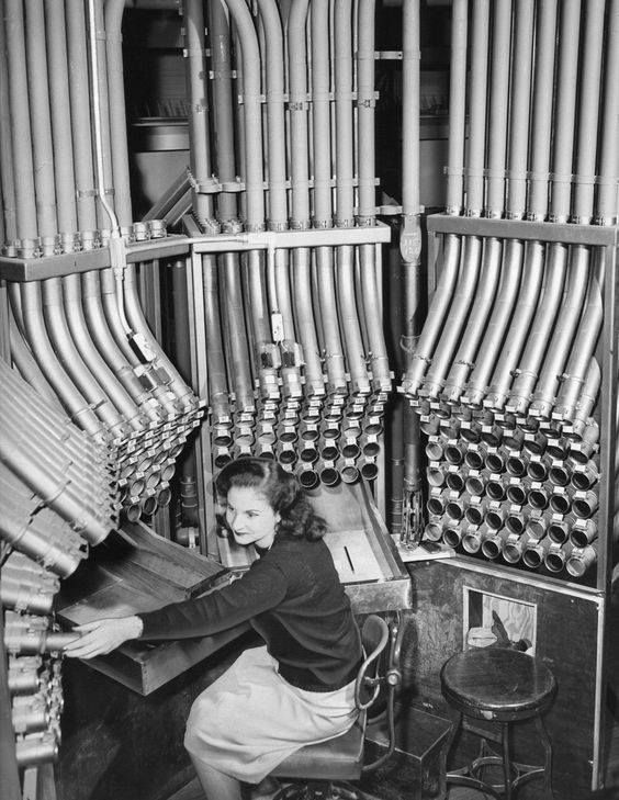 Helen Soros works the new pneumatic tube system to take cash at Marshall Fields store in Chicago, November 1947.