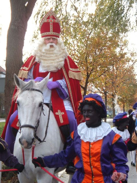 """Each year, toward the end of November, the big day is here. Sinterklaas, on his white horse, and together with many of his helpers called """"Zwarte Pieten"""", he arrives in Amsterdam to celebrate his b-day on Dec.5th,  with all the children in Holland..."""