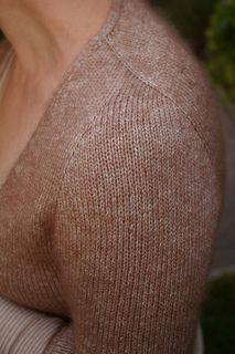 knitted from the top down cardigan with slanted contiguous method sleeve