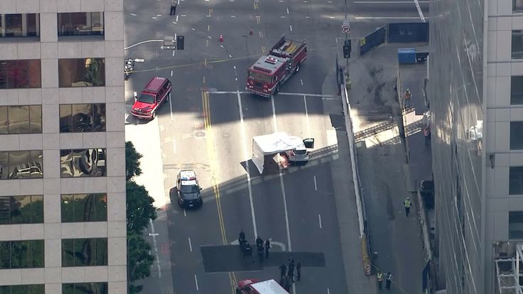 A construction worker died after falling from the under-construction Wilshire Grand Tower and landing on a passing car in downtown L.A. early Thursday afternoon, according to the Los Angeles Fire D…