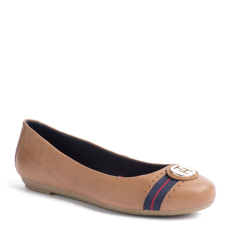 The essential ballerina is a must-have for Spring. Leather upper with striped grosgrain tape and Tommy Hilfiger medallion on the toe cap. Textile lining, leather sock lining. Rubber outsole