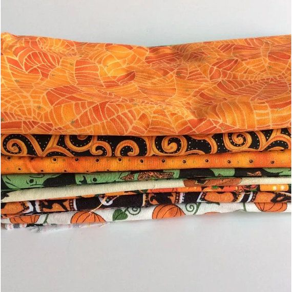Lot of 9 pieces of Halloween fabric/material, ideal to build your Quilt/craft stash. Pieces are anywhere from 16x16 to 24x41-42. A variety of patterns and shades of orange. Lot weighs approximately 1 pound 4 ounces. What is pictured is what you will receive plus a couple extra