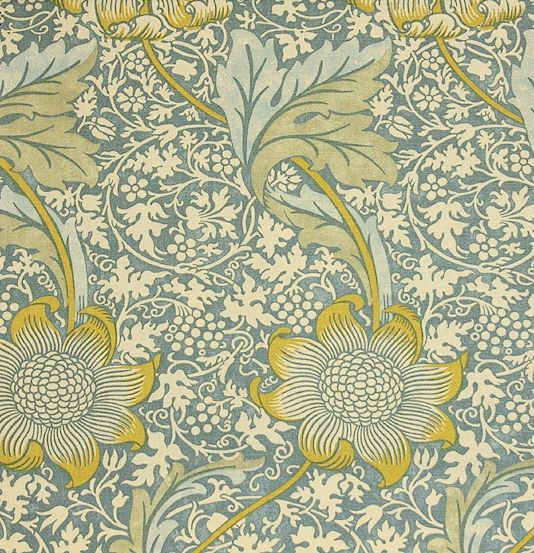 Kennet Linen Fabric A large scale floral in gold with a smaller floral background printed with a dark aqua background