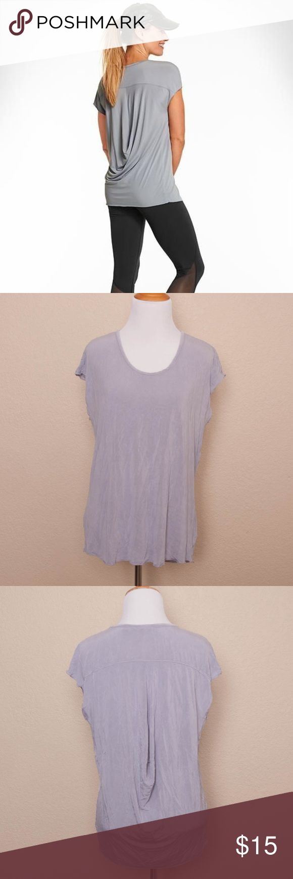 "Athleta Ciao Bella Draped Back Tunic Top ""Ciao Bella Tunic""  Gray, semi-sheer, silky jersey tee with draped back  94% Cupro, 6% Spandex  Machine wash  Made in Vietnam  Measurements:  Bust: 38""  Waist: 36""  Overall Length: 25""  Condition:  Top is clean and shows minimal wear; no holes, stains, pulls, or pilling. Athleta Tops"