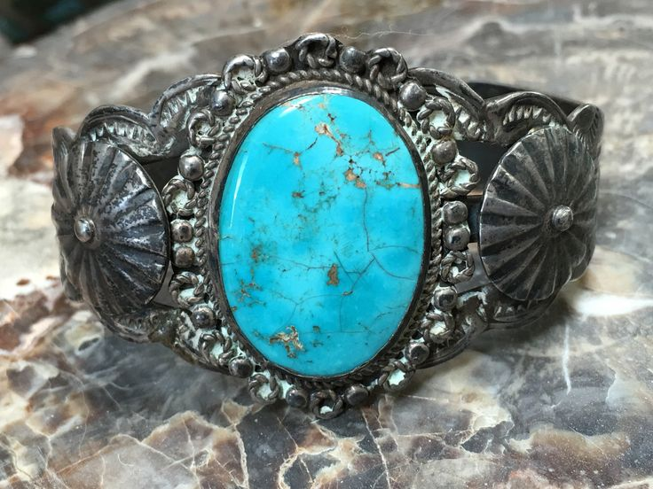 Early Navajo cuff bracelet. Fred Harvey train station era. Hand-stamp decorated with appliqué fluted buttons. Set with natural, untreated Cerillos Mine turquoise. Stone is crazed because it was never