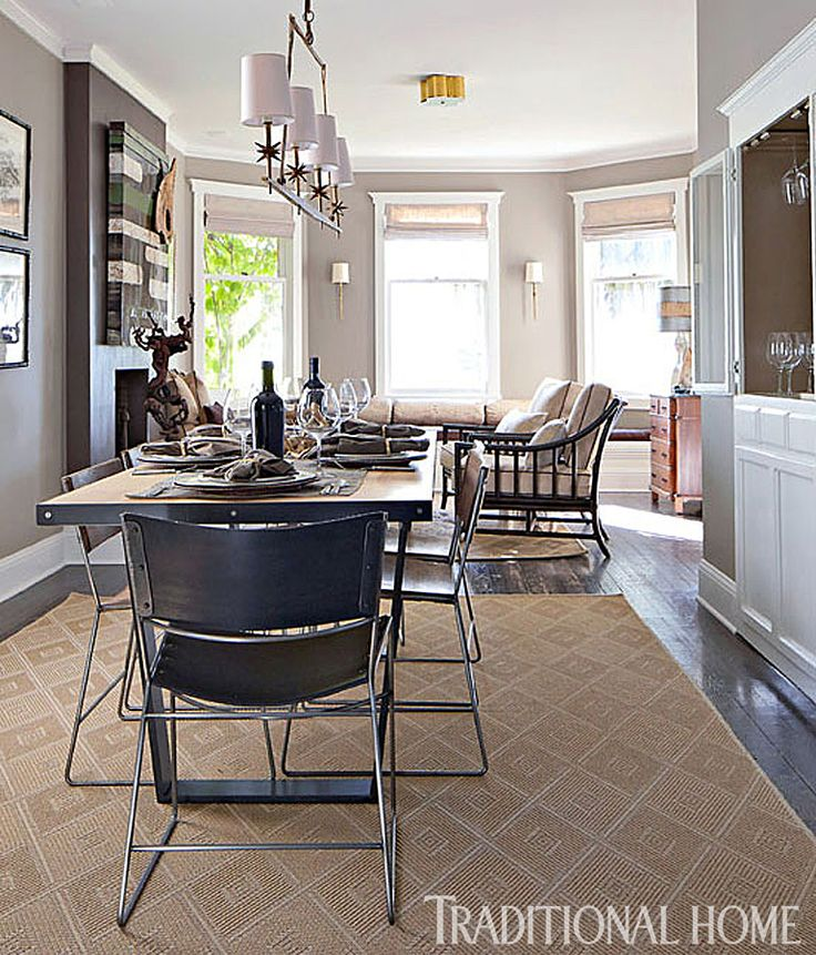 A Custom Dining Table Is Surrounded By Chairs Crafted From