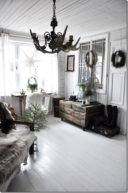 Whitewashed floors, walls and ceiling and black chandelier.  LL