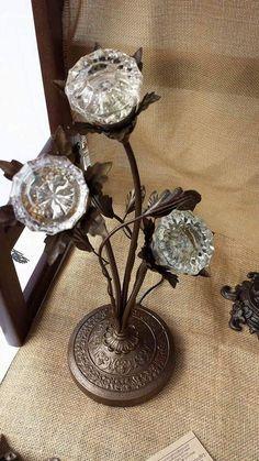 Floral arrangement of crystal doorknobs in antique repurposed base - crystal doorknobs lighted