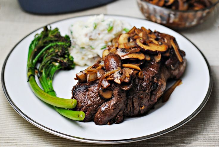 Ranch Steak with Onions and Mushrooms - A quick marinade tenderizes ranch steak and boosts its flavor while onions and mushrooms make the perfect accompaniment.