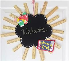 Welcome Back to school wreath I made by adhereing rulers behind a chalkboard and embellishing it with cuts from Locker Talk and Doodlecharms.