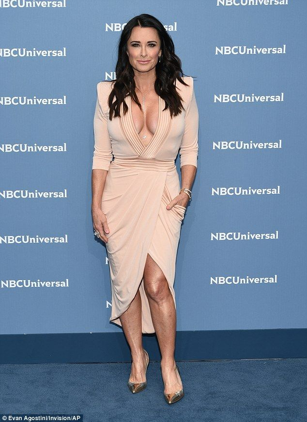 If you've got it?Kyle Richards of The Real Housewives Of Beverly Hills fame was present, showing off her chest in a racy pink number