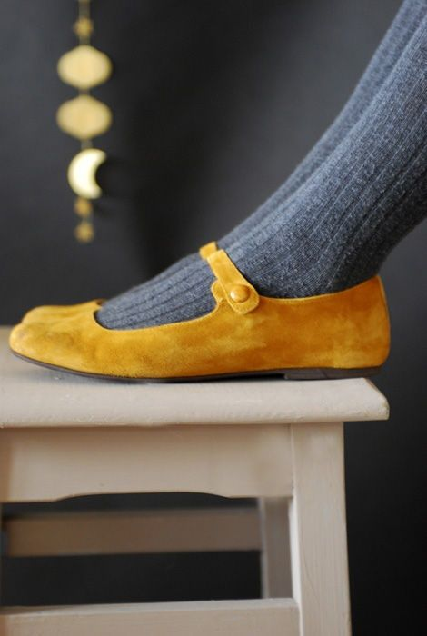 Mustard coloured suede shoes with grey ribbed stockings.