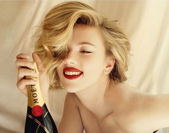 Scarlett Johansson, looking very vintage couture, for Moët et Chandon.  The ad looks just like the original wine bottle label, which of course, is the whole idea. :)