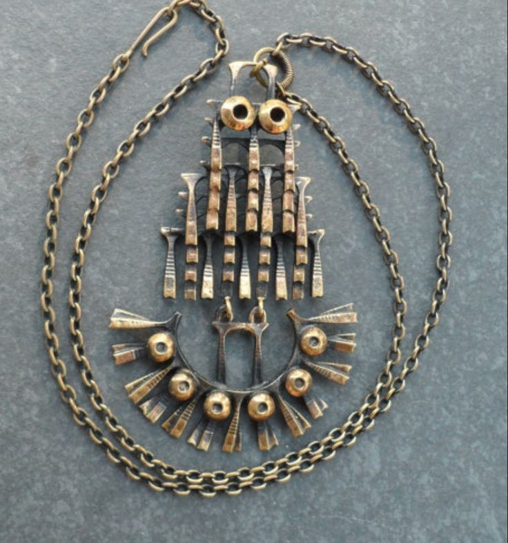"Pentti Sarpaneva for Kalevala Koru, Vintage kinetic ""Owl"" bronze pendant, 1970's."