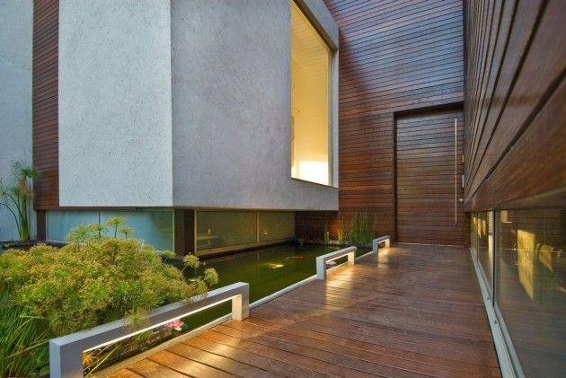 Wooden Concrete House by Nestor Sandbank
