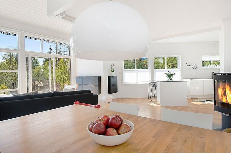Living room with kitchen in background