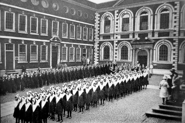 Bluecoat School was founded in 1708 or 1709 by the Reverend Robert Styth, who died in 1713 and was rector of Liverpool, and Bryan Blundell, a sea captain and twice Mayor of Liverpool in 1721–22 and 1728-29.  Constructed between 1716-17, the building wasn't extended until 1718 to function as a boarding school. This picture is of Founders' Day 1920.