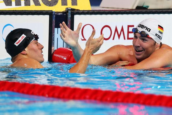 Daniel Gyurta of Hungary (L) celebrates with second placed Marco Koch of Germany after the Swimming Men's Breaststroke 200m Final on day fourteen of the 15th FINA World Championships at Palau Sant Jordi on August 2, 2013 in Barcelona, Spain.