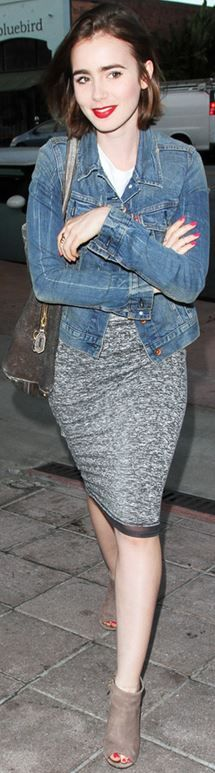 Lily Collins in denim jacket and grey pencil skirt.