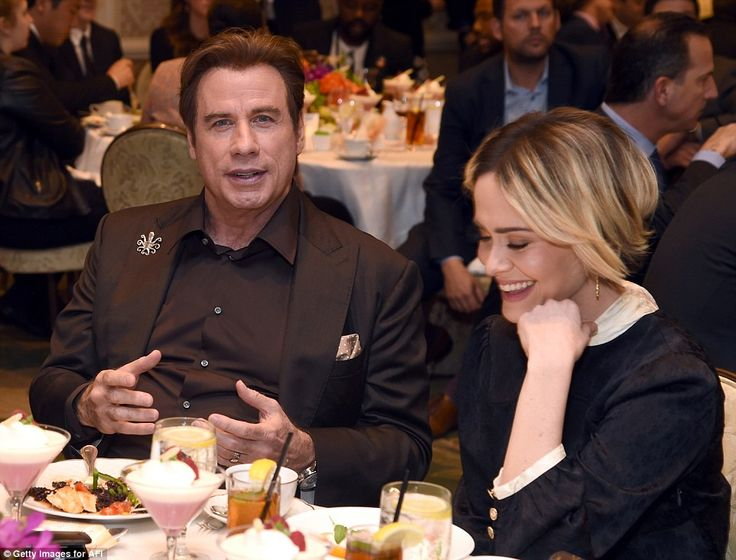 Lawyers reunited: Paulson, who on The People V OJ Simpson played prosecutor Marcia Clark, was sat at the event with John Travolta, who played Simpson defense attorney Robert Shapiro