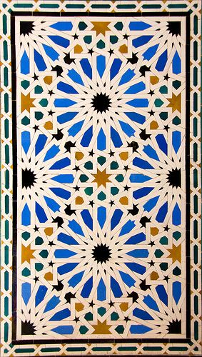 Islamic tile design. Spain.  I like how eight stars in the center make a square.
