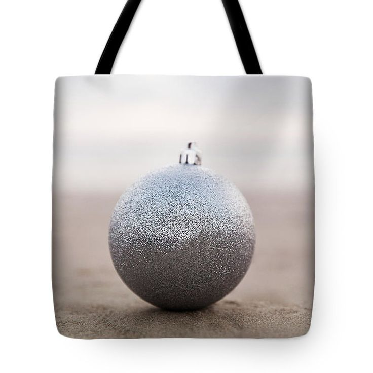 Tote Bag featuring the photograph Simple Silver by Evgeniya Lystsova. Silver Christmas ball at the beach at sunset time in sepia tone, winter holiday concept. Tote Bag in pastel colors for your winter look and Christmas / Winter Holidays. Find a Gift for you and for a friend! Each Tote Bag is machine-washable in cold water and is printed on both sides using the same image. See more styles in my gallery. #ArtProducts #ToteBag #Beach #Silver #Decorations #Christmas #Lifestyle #Accessories