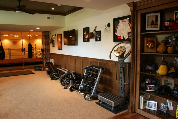 Eclectic Vintage Home - Boxing Gym: Free weights, the latest gym equipment, and a boxing ring make this retro gym a great place to hone your boxing skills and stay in shape! Photos taken by Dempsey Ward. (Home Design & Decor by B.L. Rieke & Associates, Inc.) #eclectic #vintage #Rocky #boxinggym #weightroom #dreamhome #customhome #homedesign Visit our website: http://www.blrieke.com/ Visit our #Houzz page: http://www.houzz.com/pro/blrieke/