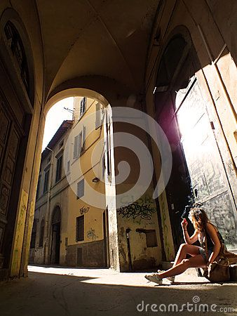 Old street arches sun reflecting on metal door meditation