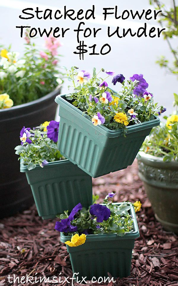Cheap & easy fix for a boring front walk: flowerpots stacked on a skewer.