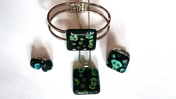 Check out this item in my Etsy shop https://www.etsy.com/listing/469457462/special-dichroic-glass-jewelry-set-with