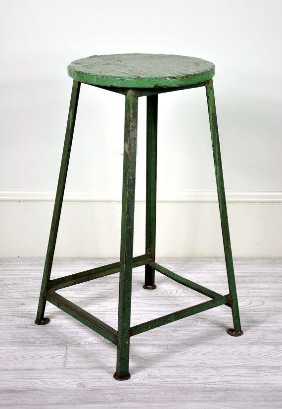 old green metal stool