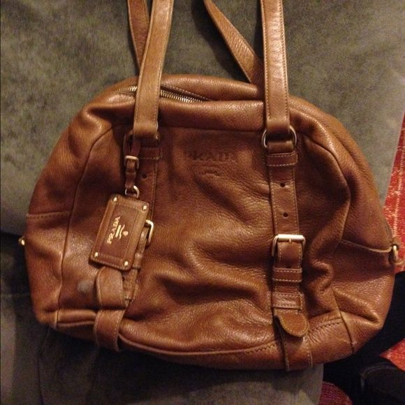 Holiday sale! Prada handbag Beautiful chocolate brown Prada handbag. I love this bag, but my style has changed over the past year. It is in great condition. Prada Bags