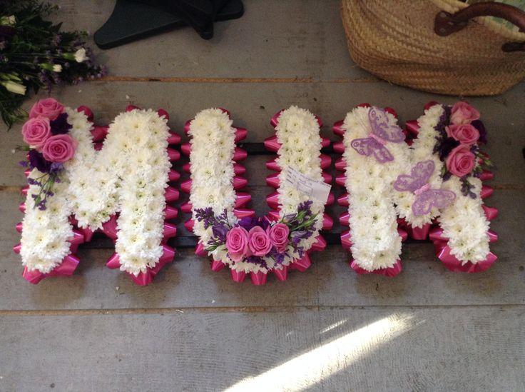 Funeral Flowers. Mum funeral flower letters, flowers for mums funeral, pink and white funeral flowers, butterflies www.thefloralartstudio.co.uk