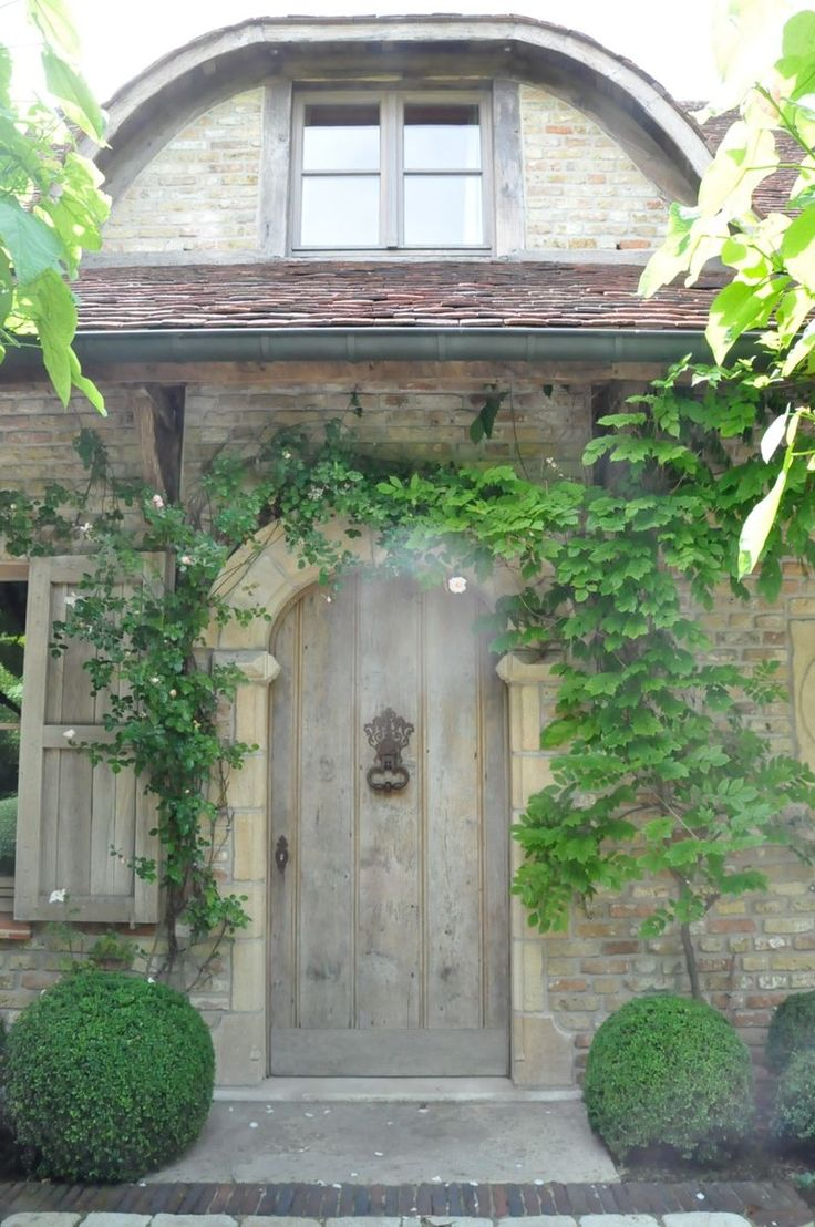 Charming Character Stone Facade Arched Door Rustic