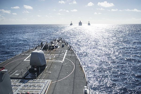 The Arleigh Burke-class guided missile-destroyer USS Fitzgerald (DDG 62) prepares to come alongside the Military Sealift Command underway replenishment oiler USNS Tippecanoe (T-AO-199) while it participates in a replenishment at sea with the Arleigh Burke-class guided missile-destroyer USS Curtis Wilbur (DDG 54) and the Arleigh Burke-class guided missile-destroyer USS Mustin (DDG 89).
