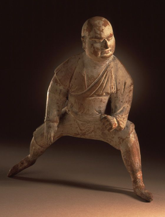 Funerary Sculpture of a Wrestler.  China, Middle Tang dynasty, about 700-800.  Sculpture.  Molded earthenware with incised decoration and traces of white slip. LACMA Collections