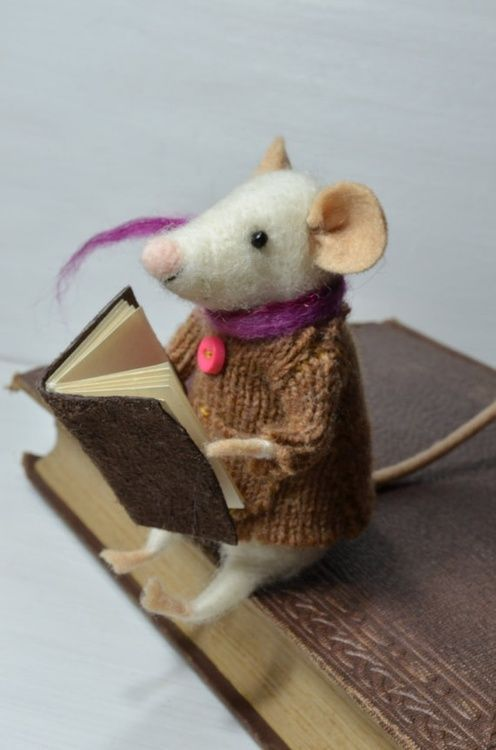 A little felt mouse getting his reading done. TG