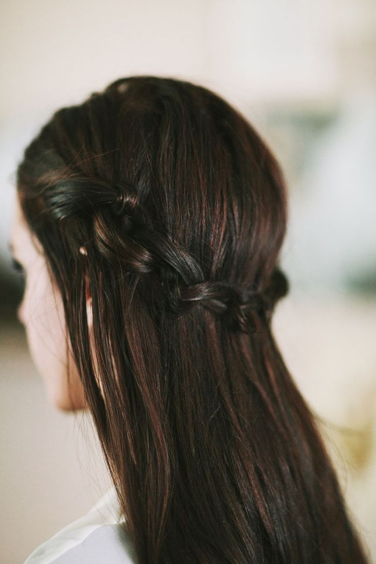 This hair tutorial is similar to the braided crown we've all come to know and love, but with a twist; er, knot. Here's how it's done:   ...