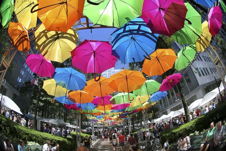 In this image made with a fisheye lens, an array of umbrellas covers a walkway at the annual Three Rivers Arts Festival on Saturday, June 3, 2017, in Pittsburgh.