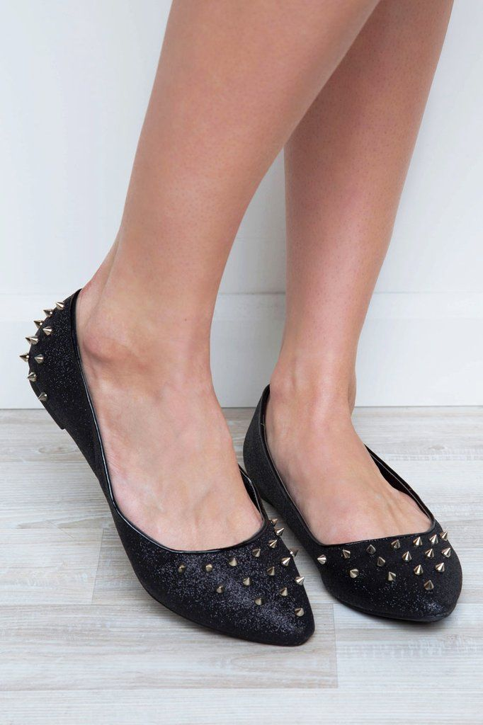 "Talk a walk on the wild side wearing these Erin Studded Flats! Feature a glittery black faux leather material with silver studded embellishments around toe and outer backs. Pointed toe. Ballet flat styling. Cushioned insole and rubber bottom sole with nonskid markings. Slip-on style.*Man Made Materials*2.75"" Shaft Height*0.25"" Heel Height*Imported"