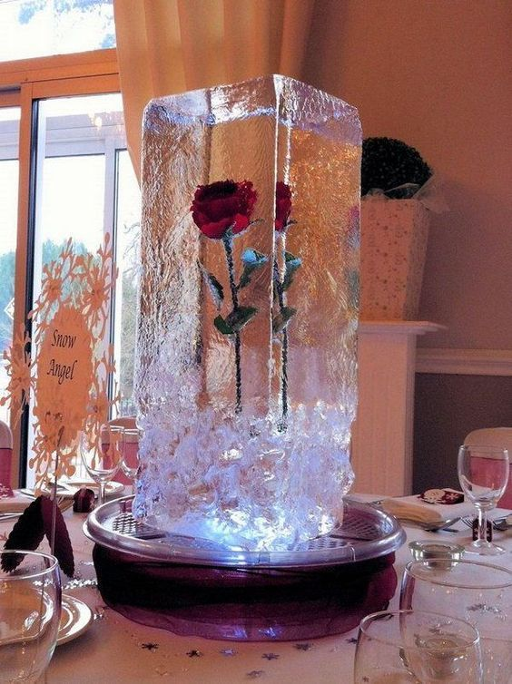 frozen rose in an ice cube is a perfect centerpiece for winter weddings
