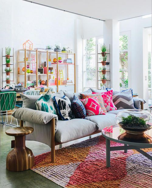 Bright and colorful living room with the cutest side table.