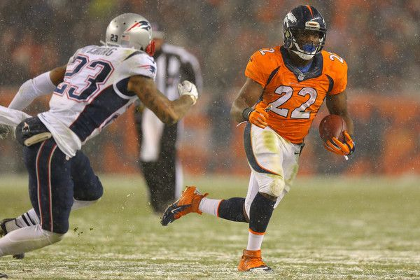 Running back Ronnie Hillman #23 of the Denver Broncos carries the ball against strong safety Patrick Chung #23 of the New England Patriots in the fourth quarter at Sports Authority Field at Mile High on November 29, 2015 in Denver, Colorado.