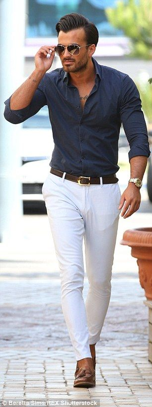 New TOWIE star Michael Hassini squeezed into a pair of tight white trousers and navy shirt...