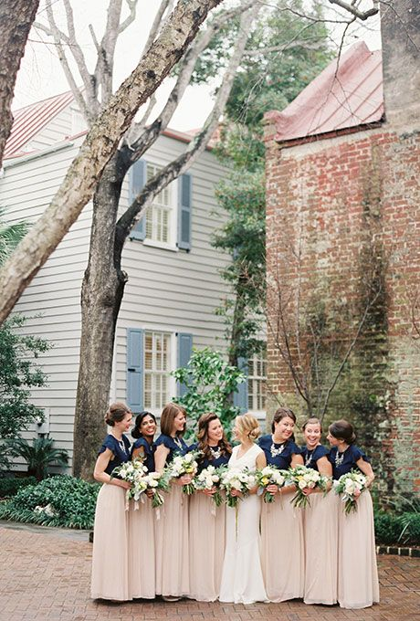 Brides.com: 30 Ways to Style Your Wedding Party Striped bridesmaid dresses add a preppy and modern twist.Photo: Love