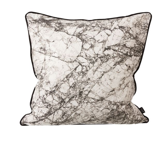 Dreaming of palatial home quarters? Ferm Living stuffs this marble-patterned silk pillow full of luxurious down, meaning it's sure to put you out cold – stone cold.