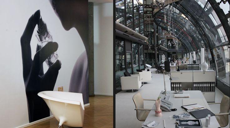 Weisser Teppichboden, weisse USM Haller Möbel und Vitra-Design Klassiker in einer lichtdurchfluteten Büro.