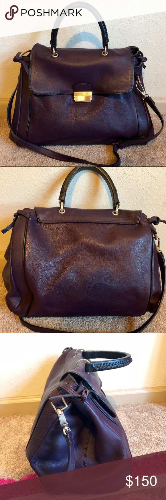 """Reiss Large Genuine Leather Tote Duffel Lock Bag Slide in lock works perfectly. Tied expandable sides. Double compartment with center zip pocket and attached inner zip pocket. Very minor wear, preowned condition. Measures 15""""x12""""x6"""" with additional expansion. Color is a dark plum. Reiss Bags Travel Bags"""