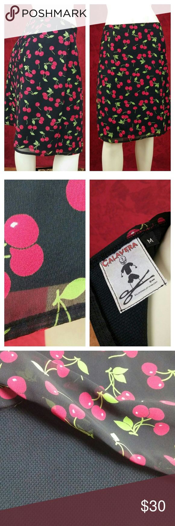 """Calavera cherry a-line knee length skirt This is a fun garment by Calvera. There is only a logo inside tag with M for a size. It appears to be heavy solid black linen underneath a layer of flowy black chiffon covered in cherries. Please see all pics and feel free to ask me anything. The waist measures 15""""1/2 and outer seam 20 1/2"""". 7 inch zipper in the back. I got it at consignment shop so not sure if it was worn at all by the perfect condition of the tag and garment itself.  I kept it…"""