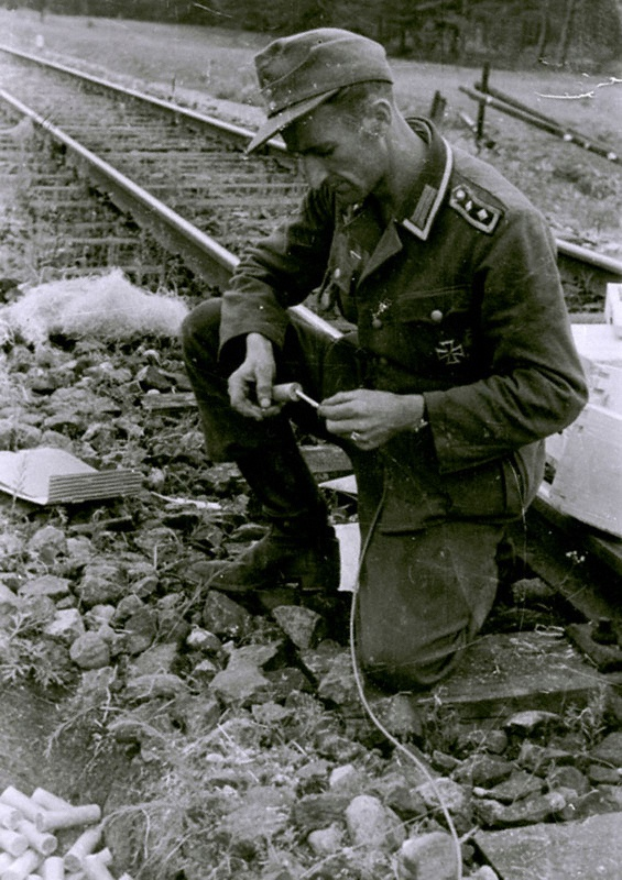 Eastern Front, Army Group Center, july 1944: German NCO prepares dynamite and fuse to blow up the railway tracks near Grodno.